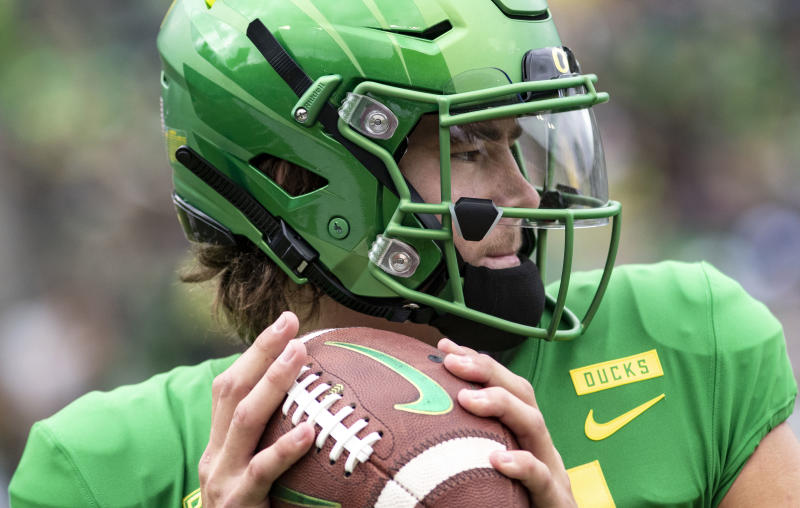 FILE - In this Saturday, Sept. 8, 2018, file photo, Oregon quarterback Justin Herbert went 20-of-26 with 250 yards, four touchdowns and no picks in their 62-14 win against Portland State during an NCAA college football game in Eugene, Ore. On the latest AP Top 25 College Football Podcast, guest Chantel Jennings previews the Pac-12's big game and gives the back story on Ducks star quarterback Justin Herbert.(AP Photo/Thomas Boyd)