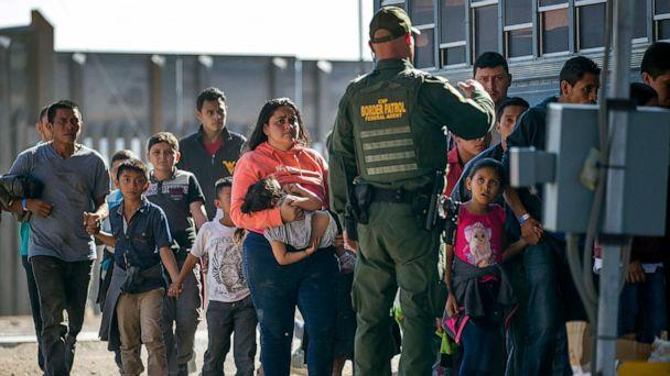 PHOTO: Migrants are loaded onto a bus by U.S. Border Patrol agents after being detained when they crossed into the United States from Mexico, June 1, 2019 in El Paso, Texas. (Joe Raedle/Getty Images, FILE)