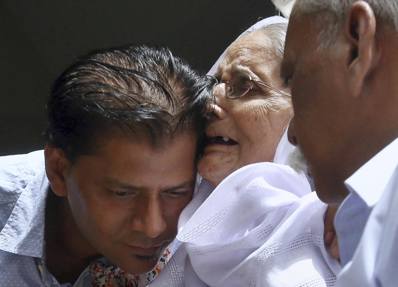 Abdul Aziz Sheikh, left, father of Sabika Sheikh, a victim of a shooting at a Texas high school, comforts to an elderly woman arriving for condolence to his daughter at his home in Karachi, Pakistan, Saturday, May 19, 2018. The Pakistani foreign exchange student is among those killed in the shooting, according to a leader at a program for foreign exchange students and the Pakistani Embassy in Washington, D.C. Megan Lysaght, manager of the Kennedy-Lugar Youth Exchange & Study Abroad program (YES), sent a letter to students in the program confirming that Sabika Sheikh was killed in the shooting. (AP Photo/Fareed Khan)