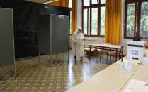A nun holds her ballot after voting for the abortion referendum at a polling station in San Marino, Sunday, Sept. 26, 2021. Tiny San Marino is one of the last countries in Europe which forbids abortion in any circumstance — a ban that dates from 1865. Its citizens are voting Sunday in a referendum calling for abortion to be made legal in the first 12 weeks of pregnancy. (AP Photo/Antonio Calanni)