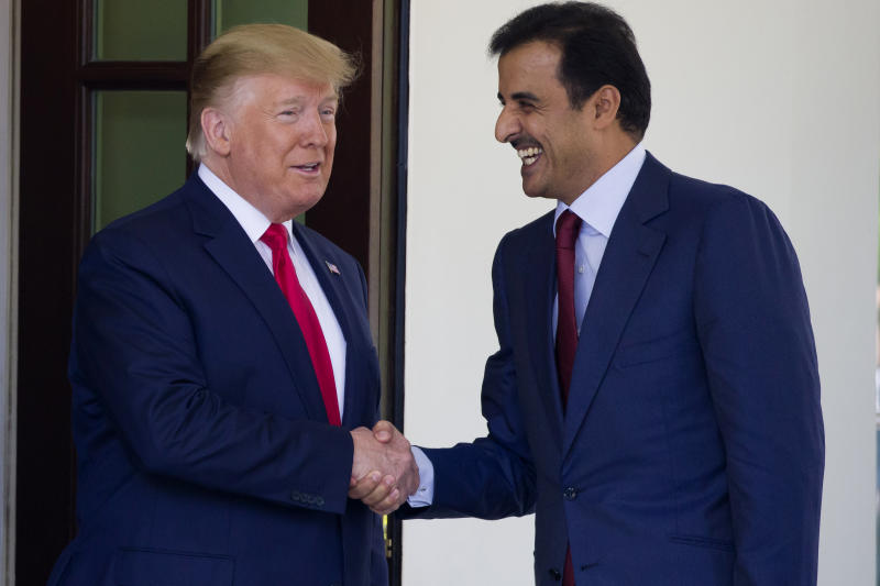 President Donald Trump shakes hands as he welcomes Qatar's Emir Sheikh Tamim bin Hamad Al Thani upon his arrival at the White House, Tuesday, July 9, 2019, in Washington. (AP Photo/Alex Brandon)