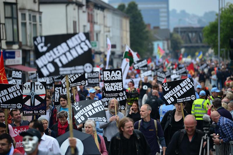 Demonstrators take part in a protest march on the sidelines of the NATO Summit in Newport, Wales, on September 4, 2014 (AFP Photo/Carl Court)