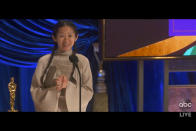 """In this video image provided by ABC, Chloe Zhao accepts the award for best director for """"Nomadland"""" at the Oscars on Sunday, April 25, 2021. (ABC via AP)"""