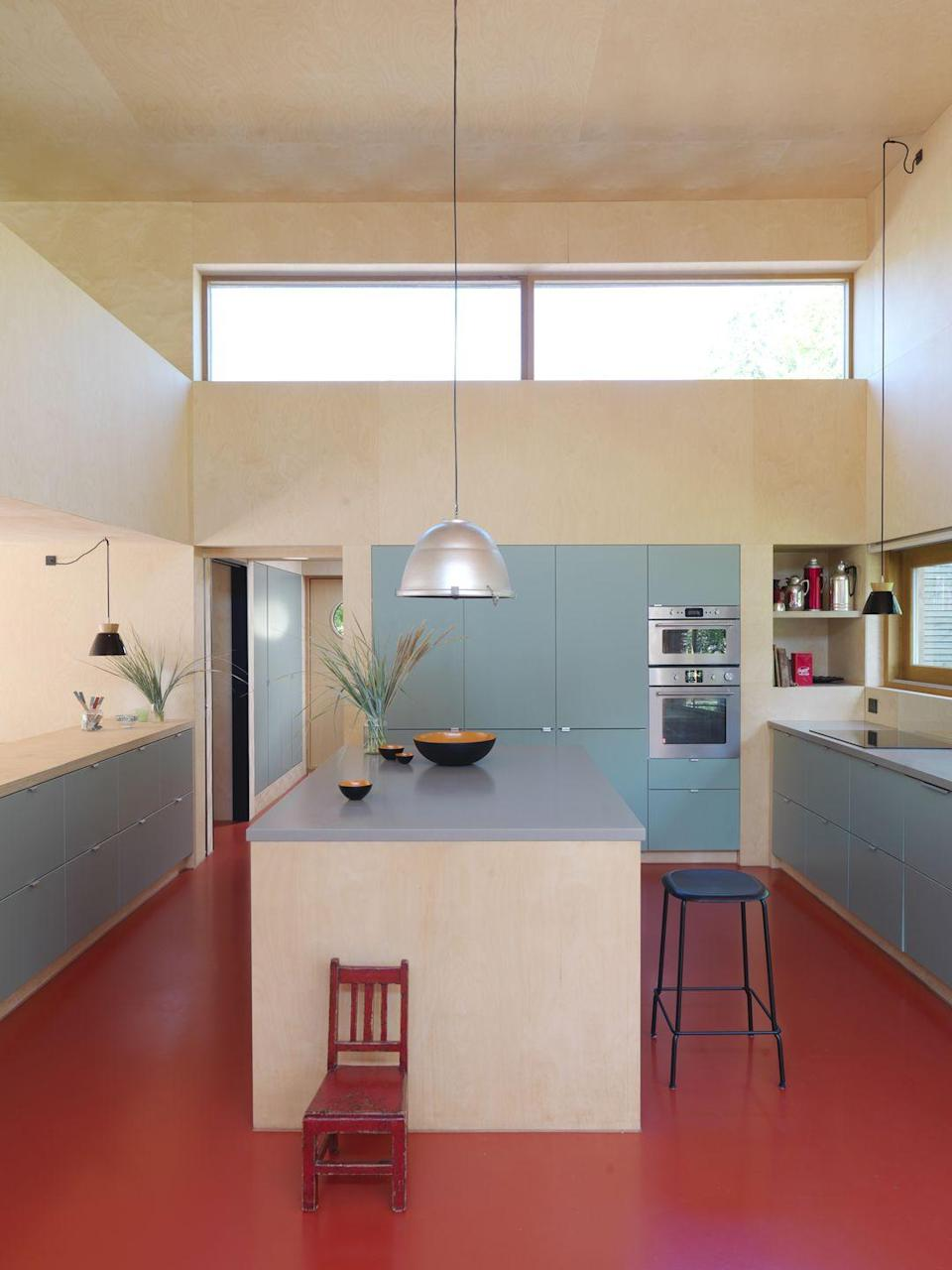 """<p>Often forgotten, the kitchen floor offers a world of opportunity to add bold colour. This <a href=""""https://elledecoration.co.uk/houses/a36761652/colourful-eco-home-denmark/"""" rel=""""nofollow noopener"""" target=""""_blank"""" data-ylk=""""slk:holiday home in Denmark"""" class=""""link rapid-noclick-resp"""">holiday home in Denmark</a> by architecture firm Cold Wet & Dark features a poured epoxy resin floor in a dramatic red shade, but there are countless vinyls and rubber options on the market for a more affordable option. Try the Colour Flooring Company for similar. <a href=""""https://www.colourflooring.co.uk/"""" rel=""""nofollow noopener"""" target=""""_blank"""" data-ylk=""""slk:colourflooring.co.uk"""" class=""""link rapid-noclick-resp"""">colourflooring.co.uk </a></p>"""