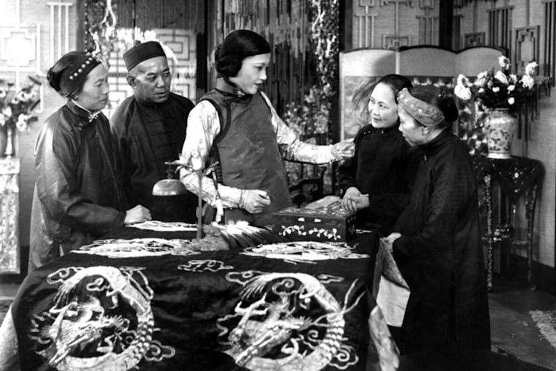 Anna May Wong (center) inThe Toll of the Sea, her first leading role | Everett