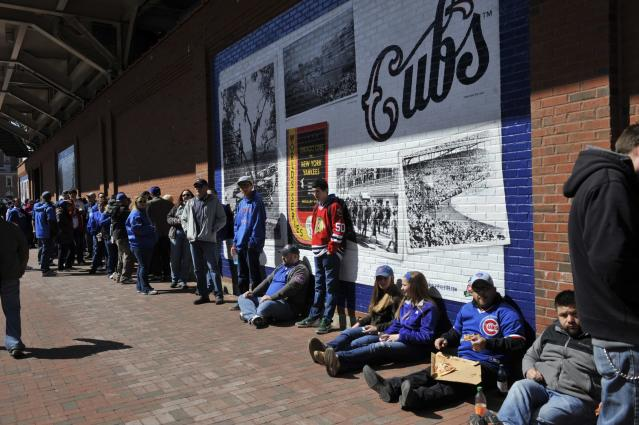 CHICAGO, IL - APRIL 23: People wait to enter the ballpark before the game between the Chicago Cubs and the Arizona Diamondbacks on April 23, 2014 at Wrigley Field in Chicago, Illinois. Today marks the 100th anniversary of the first game ever played in the historic venue. (Photo by David Banks/Getty Images)