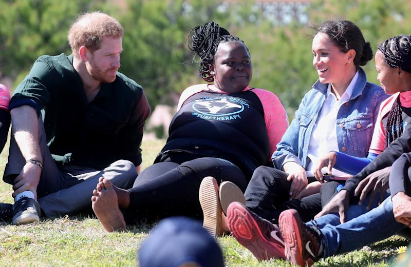 CAPE TOWN, SOUTH AFRICA - SEPTEMBER 24: Prince Harry, Duke of Sussex and Meghan, Duchess of Sussex join surf mentors and participate in a group activity to promote positive thinking, as they visit Waves for Change, an NGO, at Monwabisi Beach on September 24, 2019 in Cape Town, South Africa. Waves for Change supports local surf mentors to provide mental health services to vulnerable young people living in under resourced communities. (Photo by Chris Jackson - Pool/Getty Images)