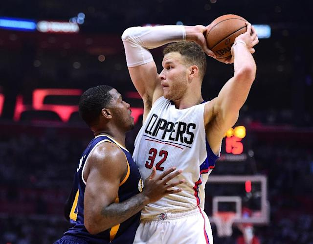 Blake Griffin of the LA Clippers is defended by Joe Johnson of the Utah Jazz during the first half, at Staples Center in Los Angeles, California, on April 15, 2017 (AFP Photo/Harry How)