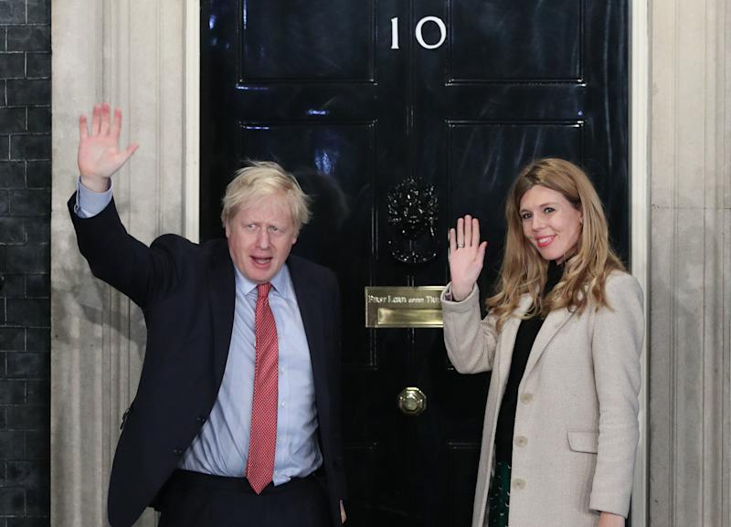 File photo dated 13/12/19 of Prime Minister Boris Johnson with partner Carrie Symonds, they have announced that they are expecting a baby in the early summer and that they have got engaged.