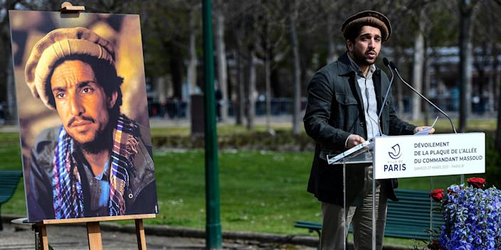 Ahmad Massoud, son of late Afghan commander Ahmad Shah Massoud, delivers a speech next to a portrait of his father in Paris, France on March 27, 2021.
