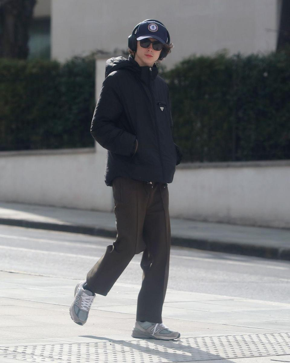 <p>Put your club allegiance side: this is one of the best transitional off-duty outfits ever. The Prada jacket is a star, as are the New Balance 990V5S – and the Chelsea cap, if that's your thing.</p>