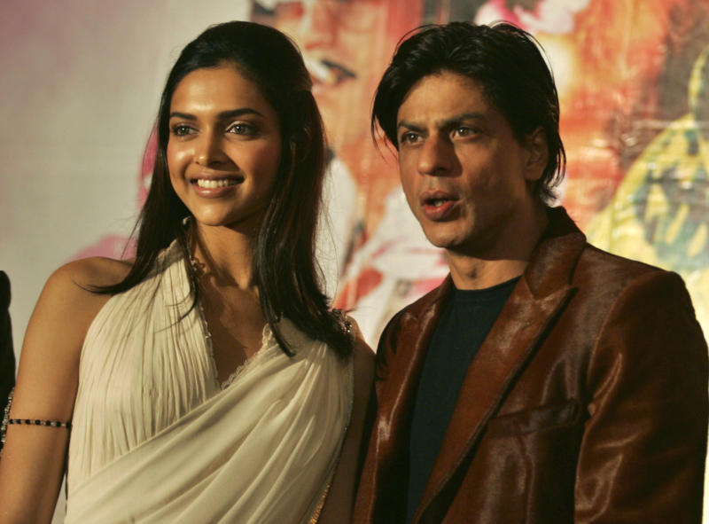 """FILE- In this Sept. 18, 2007 file photo, Bollywood actors Shah Rukh Khan, right, and Deepika Padukone attend the music launch of their Hindi film """"Om Shanti Om"""" in Mumbai, India. Veteran Indian actor and director Manoj Kumar has filed a lawsuit against Khan for releasing the popular 2007 film in Japan without deleting scenes that make fun of him. Kumar is seeking 1 billion rupees ($18.5 million) in damages from Khan and Eros International, the producers of the film, """"Om Shanti Om."""" (AP Photo/Rajesh Nirgude, File)"""