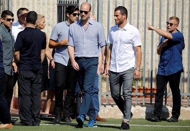 Britain's Prince William walks next to Tomer Hemed, an Israeli professional footballer who plays as a striker for English Premier League club Brighton & Hove Albion, as he arrives ahead of a soccer event with Jewish, Muslim and Christian children organized by The Equalizer and Peres Center for Peace in Jaffa, near Tel Aviv, Israel, June 26, 2018. REUTERS/Amir Cohen