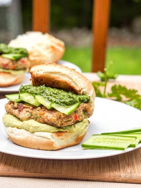 "<p>With added layers of cilantro parsley pesto and avocado hummus, this vegetarian burger is loaded with flavor. It makes for a nutritious meal for any hour of the day!</p> <p><strong>Get the recipe</strong>: <a href=""https://avocadopesto.com/bubba-veggie-burger-pesto-avocado-hummus/"" class=""link rapid-noclick-resp"" rel=""nofollow noopener"" target=""_blank"" data-ylk=""slk:bubba veggie burger with cilantro parsley pesto and avocado hummus"">bubba veggie burger with cilantro parsley pesto and avocado hummus</a></p>"