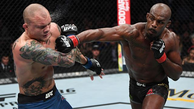 Anthony Smith absorbs a punch from Jon Jones at UFC 235. (Zuffa LLC)