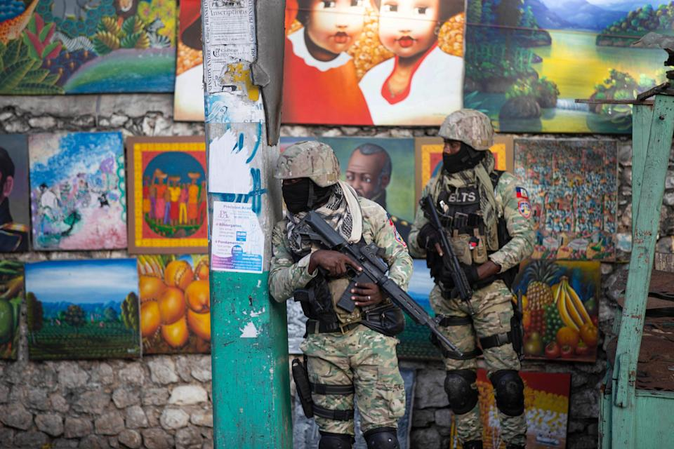 Soldiers patrol in Petion Ville, the neighborhood where Haitian President Jovenel Moise lived in Port-au-Prince. Moise was assassinated July 7 in an attack on his private residence, and first lady Martine Moise was shot and hospitalized, according to a statement from the country's interim prime minister.