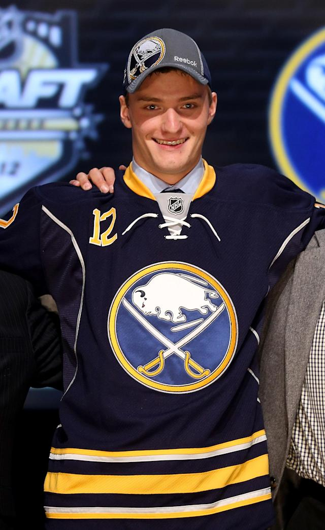 PITTSBURGH, PA - JUNE 22: Mikhail Grigorenko, 12th overall pick by the Buffalo Sabres, poses on stage during Round One of the 2012 NHL Entry Draft at Consol Energy Center on June 22, 2012 in Pittsburgh, Pennsylvania. (Photo by Bruce Bennett/Getty Images)