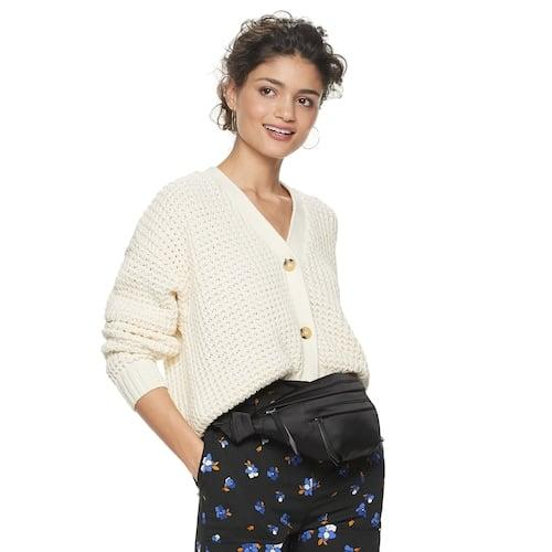 "<p><a href=""https://www.popsugar.com/buy/POPSUGAR-Long-Sleeve-Cardigan-532070?p_name=POPSUGAR%20Long%20Sleeve%20Cardigan&retailer=kohls.com&pid=532070&price=50&evar1=fab%3Aus&evar9=47019500&evar98=https%3A%2F%2Fwww.popsugar.com%2Ffashion%2Fphoto-gallery%2F47019500%2Fimage%2F47019511%2FPOPSUGAR-Long-Sleeve-Cardigan&list1=shopping%2Cwinter%2Cproducts%20under%20%24100%2Cwinter%20fashion%2Cwinter%20shopping%2Cfashion%20shopping%2Caffordable%20shopping%2Cpopsugar%20at%20kohls&prop13=api&pdata=1"" rel=""nofollow"" data-shoppable-link=""1"" target=""_blank"" class=""ga-track"" data-ga-category=""Related"" data-ga-label=""https://www.kohls.com/product/prd-3944101/womens-popsugar-long-sleeve-cardigan.jsp?color=Jet%20Black&amp;prdPV=4"" data-ga-action=""In-Line Links"">POPSUGAR Long Sleeve Cardigan</a> ($50)</p>"