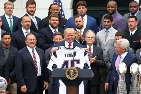 Apr 19, 2017; Washington, DC, USA; President Donald Trump (M) holds a team jersey as New England Patriots owner Robert Kraft (R) and Patriots head coach Bill Belichick (L) look on at a ceremony honoring the Super Bowl LI champion New England Patriots on the South Lawn at the White House. Mandatory Credit: Geoff Burke-USA TODAY Sports