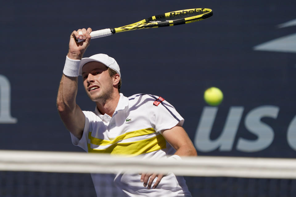 Botic Van de Zandschulp, of the Netherlands, returns a shot to Daniil Medvedev, of Russia, during the quarterfinals of the US Open tennis championships, Tuesday, Sept. 7, 2021, in New York. (AP Photo/Elise Amendola)