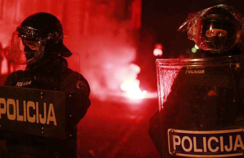 Riot police officers stand guard outside the city hall during a protest in Maribor, Slovenia, Monday, Dec. 3, 2012. Anti government protests were held throughout Slovenia the day after presidential elections (AP Photo/Darko Bandic)