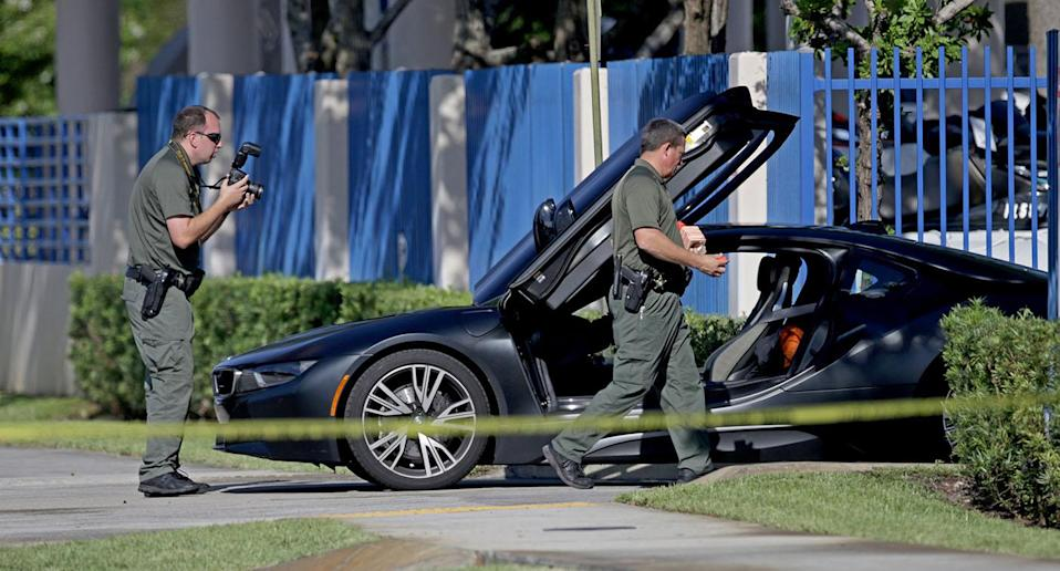 A BMW sits idle after reports of a shooting in Deerfield Beach involving Broward rapper XXXTentacion on Monday, June 18, 2018. Source: Getty