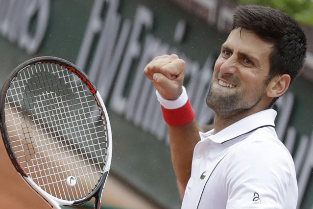 Serbia's Novak Djokovic clenches his fist after scoring a point against Spain's Roberto Bautista Agut during their third round match of the French Open tennis tournament at the Roland Garros stadium in Paris, France, Friday, June 1, 2018. (AP Photo/Alessandra Tarantino)