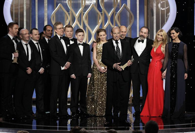 "This image released by NBC shows Executive Producer Howard Gordon, foreground, accepting the award for best TV drama series for ""Homeland"" during the 70th Annual Golden Globe Awards at the Beverly Hilton Hotel on Jan. 13, 2013, in Beverly Hills, Calif. (AP Photo/NBC, Paul Drinkwater)"