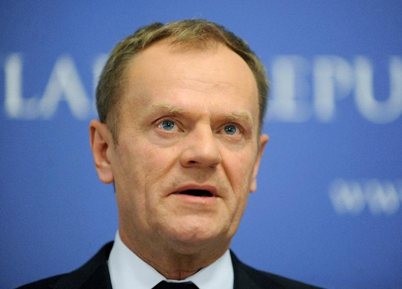 """Asked about barbed wire fences, President of the European Council Donald Tusk said: """"I'm afraid that sometimes you need tougher measures if you, we want really to apply Schengen. Sorry but this is the reality."""" (AFP Photo/)"""