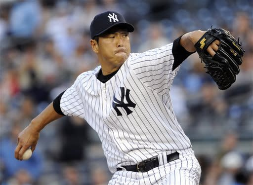 New York Yankees pitcher Hiroki Kuroda delivers the ball to the Toronto Blue Jays during the first inning of a baseball game, Friday, May 17, 2013, at Yankee Stadium in New York. (AP Photo/Bill Kostroun)