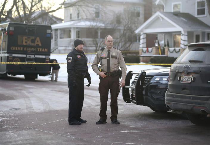 Law enforcement officers work at the scene of a shooting in Waseca, Minn., on Tuesday, Jan. 7, 2019. A Waseca police officer and a suspect were shot Monday night after reports of a disturbance in a residential neighborhood, according to the Minnesota Bureau of Criminal Apprehension. (David Joles/Star Tribune via AP)