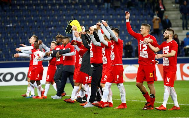 Soccer Football - Europa League - RB Salzburg vs Vitoria S.C. - Red Bull Arena Salzburg, Salzburg, Austria - November 23, 2017 Red Bull Salzburg players celebrate in front of the fans at the end of the match REUTERS/Leonhard Foeger