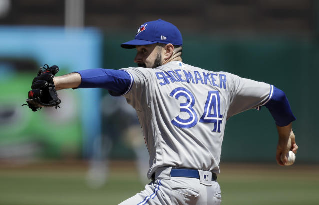 Toronto Blue Jays pitcher Matt Shoemaker works against the Oakland Athletics in the first inning of a baseball game Saturday, April 20, 2019, in Oakland, Calif. (AP Photo/Ben Margot)