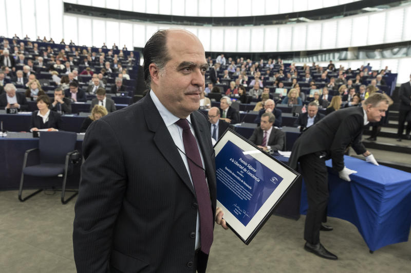 FILE - In this Dec.13, 2017 file photo, president of Venezuelan parliament Julio Borges leaves after receiving the Sakharov Prize for Freedom of Thought, an award given to Venezuela's opposition, in Strasbourg, eastern France. On Tuesday, Aug. 7, 2018, Venezuelan President Nicolas Maduro implicated Borges, one of the country's most prominent opposition leaders, in an alleged assassination attempt using drones. (AP Photo/Jean-Francois Badias, File)