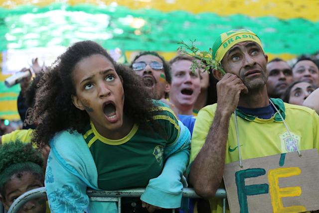 "Fans react as they watch the broadcast of the FIFA World Cup Group E soccer match between Brazil and Switzerland, in Rio de Janeiro, Brazil June 17, 2018. The sign reads: ""Faith."" REUTERS/Sergio Moraes"