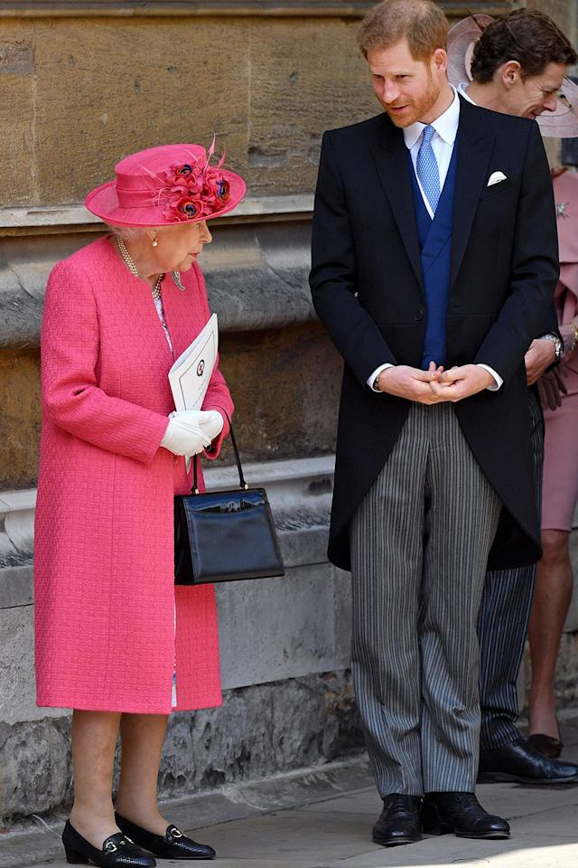 The Queen has a little chat with Prince Harry