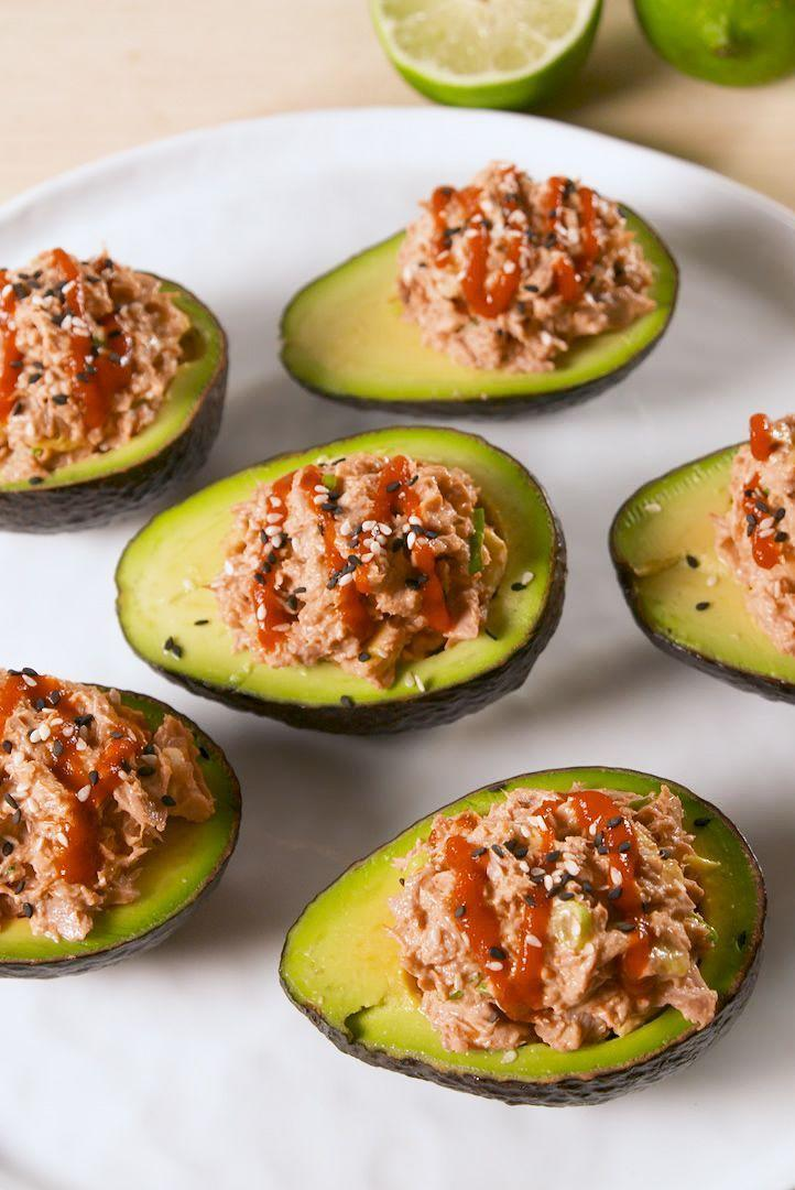 """<p>Tinned tuna for sushi-style spicy tuna?! YES. Trust us, it's amazing in these stuffed avocados. </p><p>Get the <a href=""""https://www.delish.com/uk/cooking/recipes/a35921334/spicy-tuna-stuffed-avocados-recipe/"""" rel=""""nofollow noopener"""" target=""""_blank"""" data-ylk=""""slk:Spicy Tuna Stuffed Avocados"""" class=""""link rapid-noclick-resp"""">Spicy Tuna Stuffed Avocados</a> recipe.</p>"""