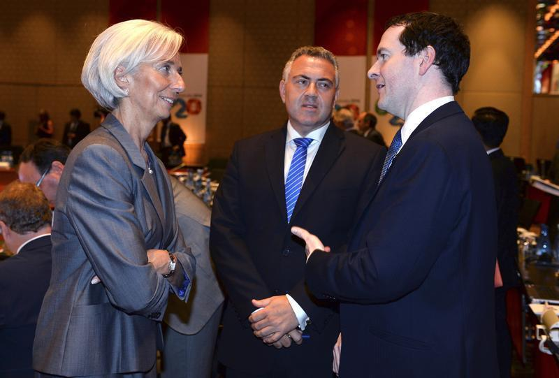 International Monetary Fund Managing Director Christine Lagarde chats with Britain's Chancellor of the Exchequer George Osbourne and Australia's Treasurer Joe Hockey in Sydney