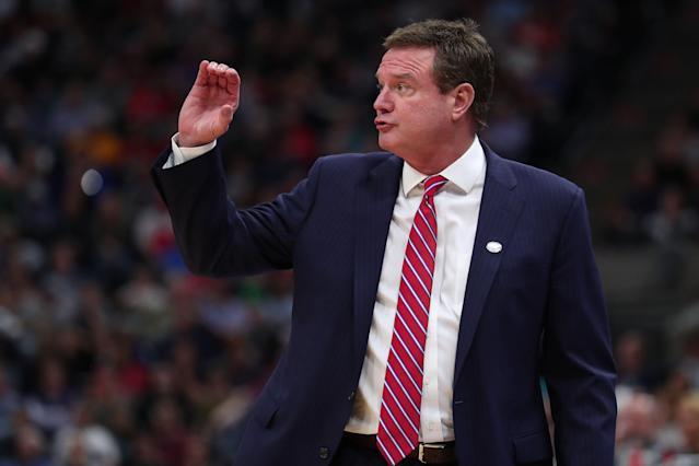 Kansas and Bill Self had no problem playing the victim, and even less problem taking $196 million from the company that 'victimized' them. (Getty Images)