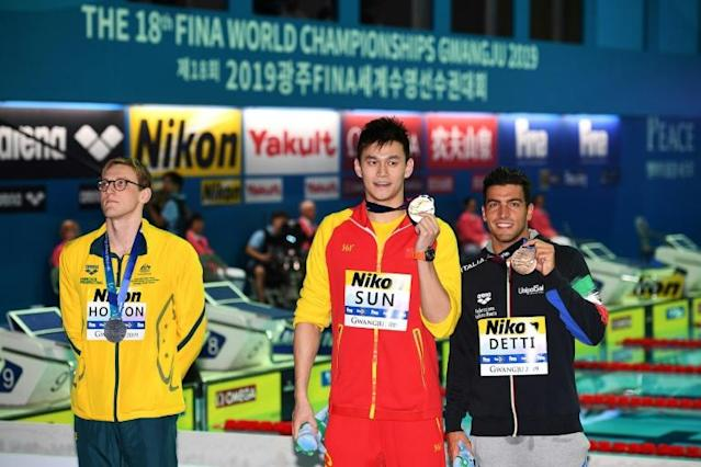 There was bad blood on the podium as Australia's silver medallist Mack Horton (left), refused to pose with China's gold winner Sun Yang and Italy's Gabriele Detti, who took bronze (AFP Photo/Oli SCARFF)