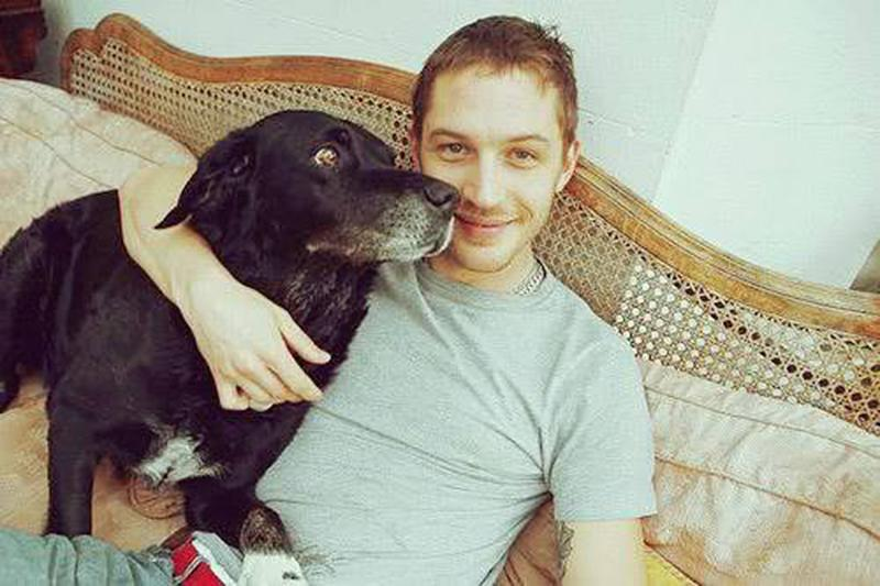 """<p>The future star of <em>Mad Max</em> once had a dog named after the character. He's shared a circa 2006 throwback pic of himself hugging up to the buddy he used to insist on bringing along to acting class. (Photo: <a rel=""""nofollow noopener"""" href=""""https://www.facebook.com/TomHardyUK/photos/a.643638628980503.1073741829.555896884421345/657085090969190/?type=3&theater"""" target=""""_blank"""" data-ylk=""""slk:Tom Hardy via Facebook"""" class=""""link rapid-noclick-resp"""">Tom Hardy via Facebook</a>)<br><br></p>"""