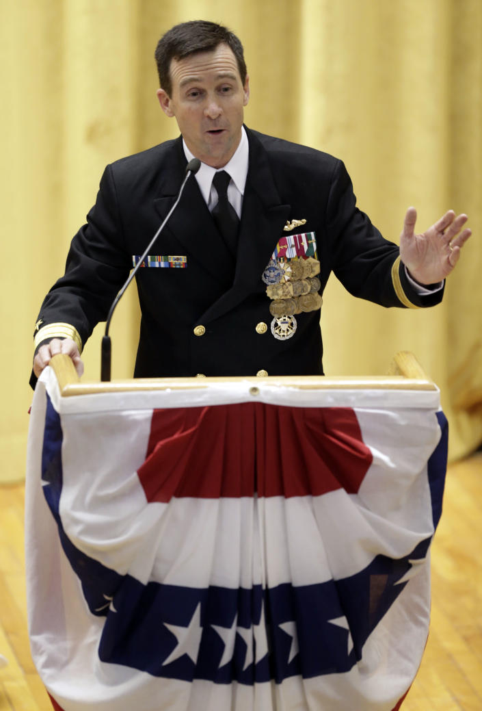 """Rear Admiral Ken Perry speaks at the decommissioning ceremony for the fire-damaged USS Miami nuclear submarine at the Portsmouth Naval Shipyard, Friday, March 28, 2014, in Kittery, Maine. Perry, commander of the submarine Group Two in Groton, Conn., where the sub was based, acknowledged the seriousness of the event, but told the crowd they were there to celebrate the submarine and its crew's achievements. """"This is a tribute. This is a celebration of the ship's performance and the superb contributions to the nation's defense and this is how we're going to treat it. So I expect to see some smiles out there,"""" he said. (AP Photo/Robert F. Bukaty)"""
