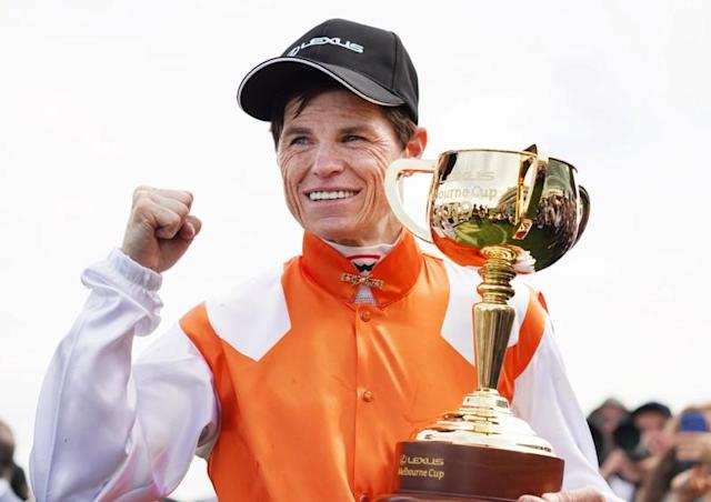 Jockey Craig Williams, of Australia, poses with the cup after winning on Vow And Declare in race 7 during the Melbourne Cup Day at Flemington Racecourse in Melbourne