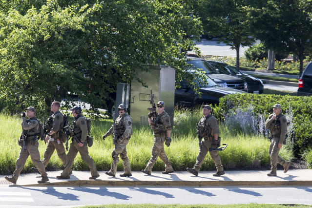 "<p>Police respond to a shooting on June 28, 2018 in Annapolis, Md. At least five people were killed Thursday when a gunman opened fire inside the offices of the Capital Gazette, a newspaper published in Annapolis, a historic city an hour east of Washington. A reporter for the daily, Phil Davis, tweeted that a 'gunman shot through the glass door to the office and opened fire on multiple employees.""There is nothing more terrifying than hearing multiple people get shot while you're under your desk and then hear the gunman reload,' Davis said. (Photo: Alex Wroblewski/Getty Images) </p>"