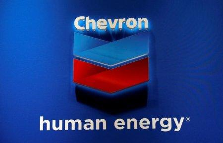 FILE PHOTO: The logo of Chevron Corp is seen in its booth at Gastech, the world's biggest expo for the gas industry, in Chiba, Japan April 4, 2017. REUTERS/Toru Hanai