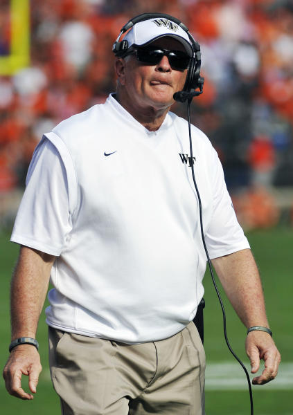 Wake Forest head coach Jim Grobe reacts to a play during the first half of an NCAA college football game against Clemson, Saturday, Sept. 28, 2013, in Clemson, S.C. (AP Photo/Rainier Ehrhardt)
