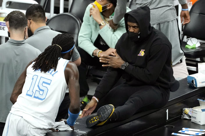 Los Angeles Lakers forward LeBron James talks to Los Angeles Lakers center Montrezl Harrell (15)