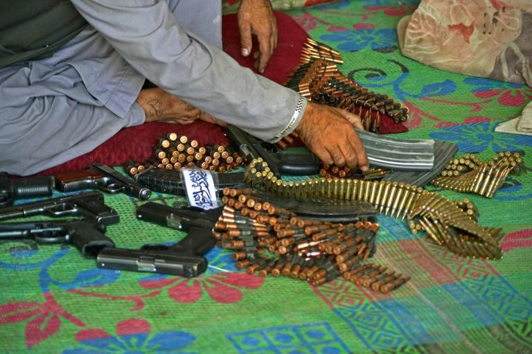 Pistols, ammunition belts and accessories are on sale in the Panjwai market (AFP/JAVED TANVEER)