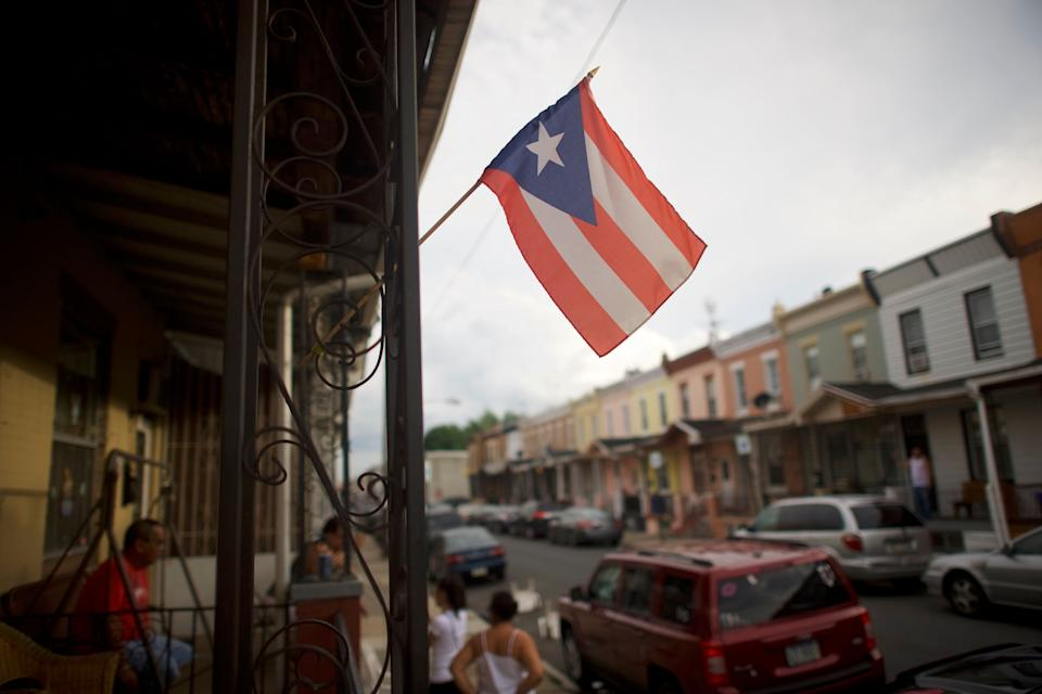 A Puerto Rican flag flies in North Philadelphia in 2018. Pennsylvania was a top destination for Puerto Ricans leaving the island after Hurricane Maria in 2017. (Photo: Mark Makela/The Washington Post via Getty Images)