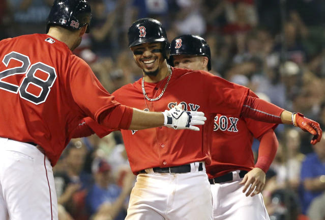 "J.D. Martinez (left) and <a class=""link rapid-noclick-resp"" href=""/mlb/players/9552/"" data-ylk=""slk:Mookie Betts"">Mookie Betts</a> (center) work on their secret handshake (AP Photo/Elise Amendola)"